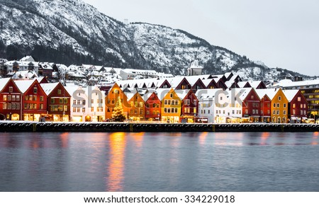 Bryggen street with wooden colored houses in Bergen at Christmas, Norway - stock photo