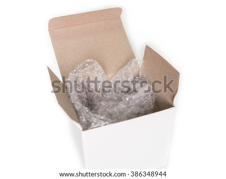 Bubble Cushioning Wrap in paper box - stock photo