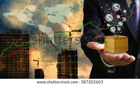 Bubble economy concept, Businessman flying dollar bubble with construction site