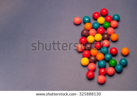 Bubble gum on blue background - stock photo