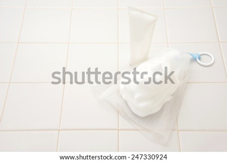 Bubble of cleansing cream and forming net for facial cleansing - stock photo