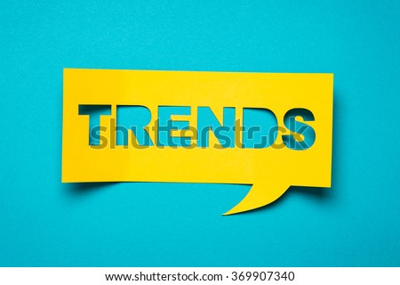"Bubble speech with cut out phrase ""trends"" in the paper. - stock photo"