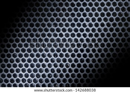 Bubble wrap lit by beam of light. Abstract backgroung - stock photo