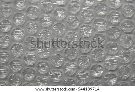 Bubble wrap used for packaging fragile items on grey background