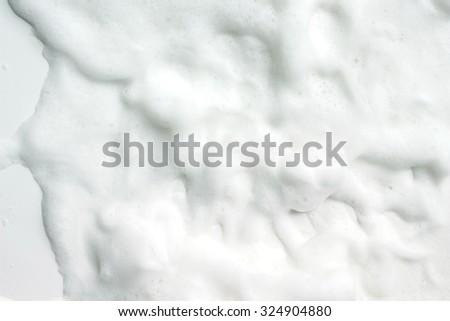 Bubbles foam white washing shower  - stock photo