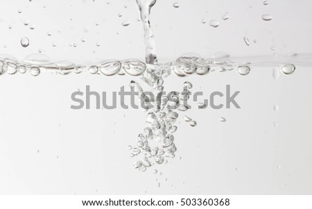 Bubbles in the water on a white background.
