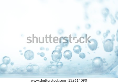 Bubbles of oxygen in glass of water on a blue background. Mineral water. Water enriched with oxygen.Oxygen. Water.Water background. Macro.Texture.Glass with water.Natural.Background.Neutral background - stock photo