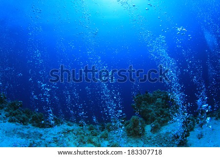 Bubbles underwater in ocean - stock photo