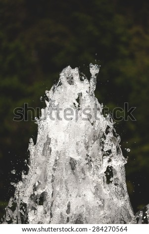 Bubbling streams of water in a fountain with foam closeup