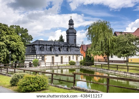 Bucha, Thuringia, Germany: Village church with green, pond and trees