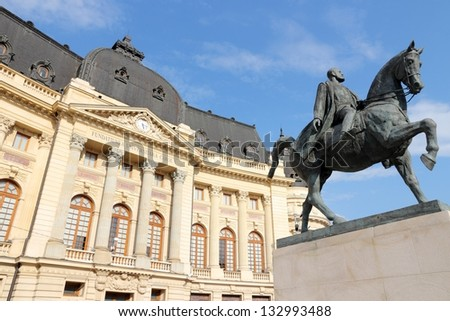 Bucharest, capital city of Romania. Central University Library and statue of king Carol I of Romania.