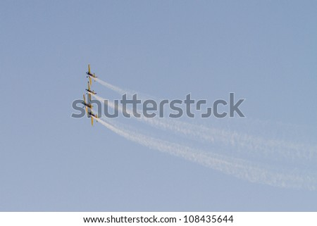 BUCHAREST - JULY 21: Airplanes perform at Bucharest International Air Show & General Aviation Exhibition (BIAS 2012) on July 21, 2012 in Bucharest, Romania