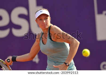 BUCHAREST - July 9: Dutch Indy DE VROOME  in action during the first round of the WTA BRD Bucharest Open, July 9 2014, Bucharest, Romania