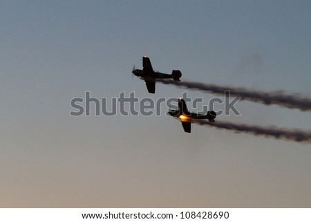 BUCHAREST - JULY 21: Evening Air Performance by Romanian Air-club at Bucharest International Air Show & General Aviation Exhibition (BIAS 2012) on July 21, 2012 in Bucharest, Romania