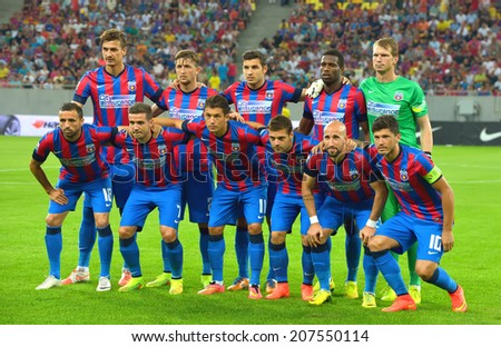 BUCHAREST-JULY,23:Football team Steaua Bucharest before the match with Stromsgodset IF Norway, during the UEFA Champions League 2nd qualifying round. Steaua won 2-0, July 23,2014 - stock photo