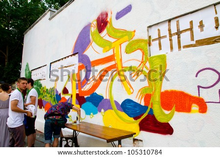 BUCHAREST - JUNE 15: Graffiti by unknown artists on Arthur Verona - Painter street done as part of the Street Delivery 2012, on June 15, 2012 in Bucharest, Romania - stock photo