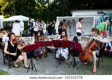 BUCHAREST - JUNE 15: Unknown artists perform on Arthur Verona - Painter street as part of Street Delivery 2012, on June 15, 2012 in Bucharest, Romania - stock photo