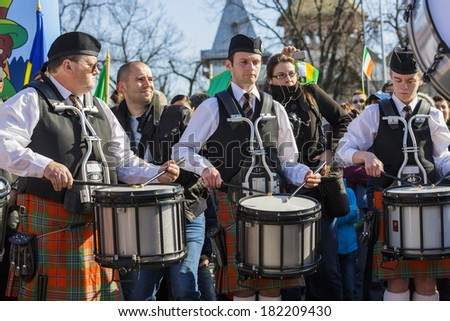 BUCHAREST - MARCH 16: Unidentified kilted Irish drum band plays the drums during the 2nd St. Patrick's Day Parade on March 16, 2014 in Bucharest, Romania. - stock photo