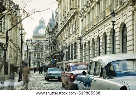 Bucharest old city with vintage cars on street