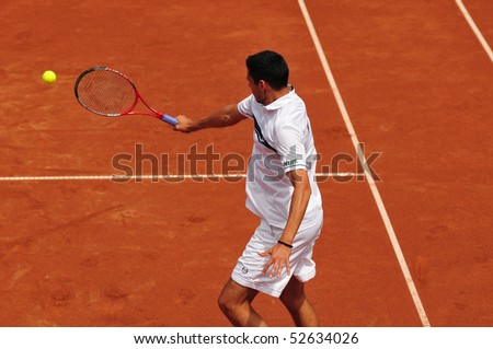 BUCHAREST, ROMAINIA  MAY 8: Romania's Victor Hanescu performs a backhand during the Davis Cup doubles meeting between Romania and Ukraine - BNR Arenas on May 8, 2010 in Bucharest, Romania. - stock photo