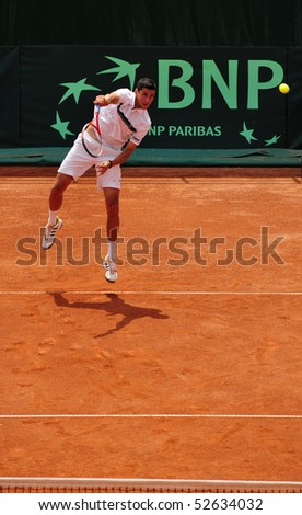 BUCHAREST, ROMAINIA  MAY 8: Romania's Victor Hanescu performs a serve during the Davis Cup doubles match between Romania and Ukraine at the BNR Arenas on May 8, 2010 in Bucharest, Romania. - stock photo