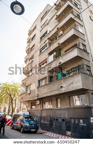 BUCHAREST, ROMANIA - APR 1, 2016: Brigada Antitero Anti Terror Brigade Squad blue van parked in front fo a building in Bucharest, Romania with pedestrians and nearby parked cars