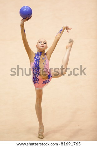 BUCHAREST, ROMANIA - APRIL 3: Anastasiya Mulmina performs during the Irina Deleanu Orange Trophy on April 3, 2011 in Bucharest, Romania - stock photo