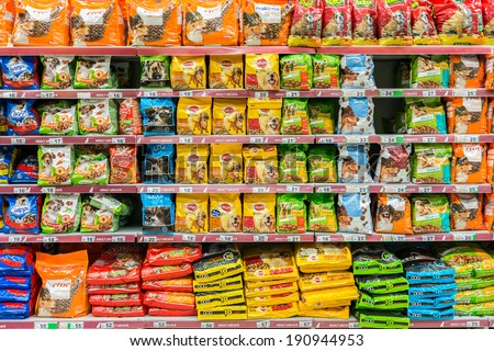 BUCHAREST, ROMANIA - APRIL 28: Dog Food Products On Animals Supermarket Shelf on April 28, 2014 in Bucharest, Romania.