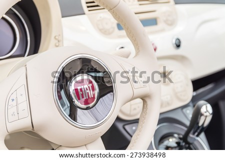 BUCHAREST, ROMANIA - APRIL 28, 2015: Fiat Car Interior View. Founded in 1899 Fiat Company in 2013 was the second largest European automaker by volumes produced, and the seventh in the world. - stock photo