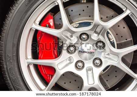 BUCHAREST, ROMANIA - APRIL 04, 2014: Ford GT Sign On Wheel And Break Pad Close Up. Ford produced the Ford GT for the 2005 to 2006 model years and is an American mid-engine two-seater sports car. - stock photo