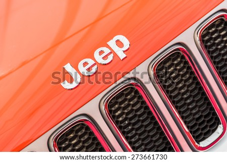 BUCHAREST, ROMANIA - APRIL 26, 2015: Jeep is a brand of American automobiles that produce solely of sport utility vehicles and off-road vehicles, but has also included pickup trucks in the past. - stock photo