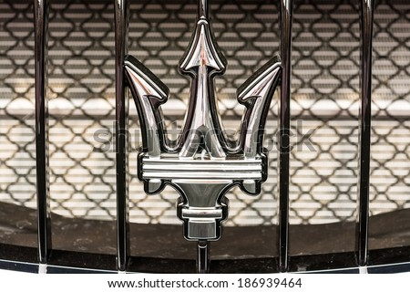 BUCHAREST, ROMANIA - APRIL 04, 2014: Maserati Sign Close Up. Maserati is an Italian luxury car manufacturer established in 1914 in Bologna and its emblem is a trident. - stock photo