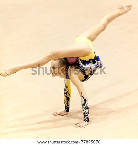BUCHAREST, ROMANIA - APRIL 3: Unknown gymnast performs during the Irina Deleanu Orange Trophy on April 3, 2011, Bucharest, Romania - stock photo