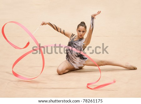 BUCHAREST, ROMANIA - APRIL 3: Unknown gymnast performs during the Irina Deleanu Orange Trophy on April 3, 2011 in Bucharest, Romania