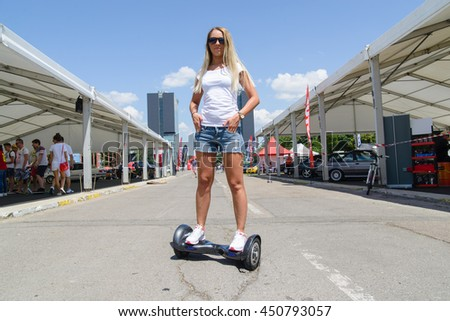 BUCHAREST, ROMANIA, - April 30, 2016: Using hoverboard, a self-balancing two-wheeled board. The gyroscope based dual wheel electric scooter is also called a smart balance wheel.