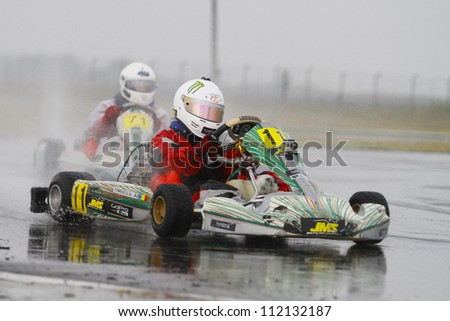 BUCHAREST, ROMANIA - AUGUST 20: Andrei Tomescu, number 11, competes in National Karting Championship, Round 5, on august 20, 2012 in Bucharest, Romania.