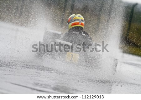 BUCHAREST, ROMANIA -  AUGUST 11: Andrei Vajda, number 1, competes in National Karting Championship, Round 5, on August 11, 2012 in Bucharest, Romania