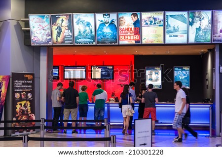 BUCHAREST, ROMANIA - AUGUST 10, 2014: People Buying Tickets At The Cinema Premiere Movies. - stock photo
