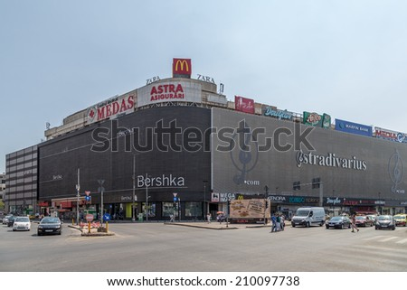 Bucharest, Romania - August 10, 2014: Unirea Shopping Center on August 10th, 2014 in Bucharest, Romania. Opened in 1976 and enlarged in 1989, it was the largest department store in Communist Romania. - stock photo