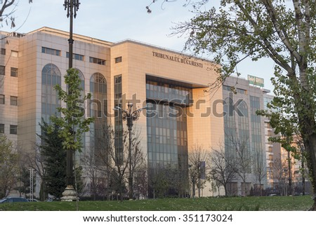 BUCHAREST, ROMANIA - CIRCA DECEMBER, 2015: Facade of the Bucharest's Court of Law, in sunset light  - stock photo