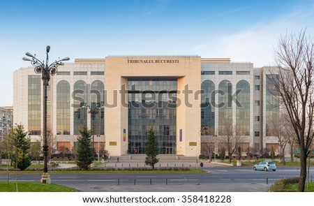 BUCHAREST, ROMANIA - CIRCA DECEMBER, 2015: Front facade of the Bucharest's Court of Law located on Unirii Boulevard, in sunset light - stock photo