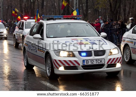 BUCHAREST, ROMANIA, DEC. 1: Military Parade on National Day of Romania, Arc de Triomphe, december 1, 2010 in Bucharest. - stock photo