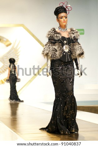BUCHAREST, ROMANIA - DECEMBER 3: Fashion model wears clothes from Catalin Botezatu collection, in Bucharest Fashion Week at World Trade Center on December 3, 2011 in Bucharest, Romania - stock photo
