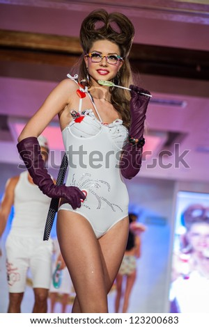 BUCHAREST, ROMANIA - DECEMBER 3: Fashion model wears clothes made by Catalin Botezatu in Bucharest Fashion Week on December 3, 2012, Bucharest, Romania