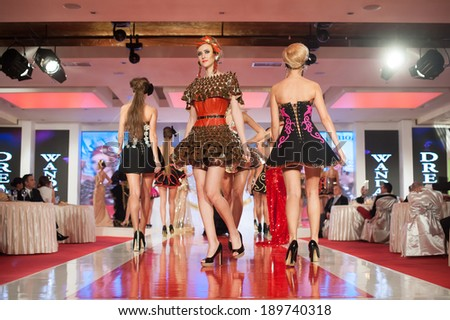 BUCHAREST, ROMANIA - DECEMBER 3: Fashion models wear clothes from Wanda's Dream collection, in Bucharest Fashion Week at World Trade Center on December 3, 2012 in Bucharest, Romania - stock photo
