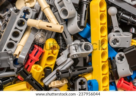 BUCHAREST, ROMANIA - DECEMBER 15, 2014: Lego Technic Pieces Pile Close Up. Technic is a line of Lego interconnecting plastic rods and parts that creates more advanced models with complex movable arms. - stock photo