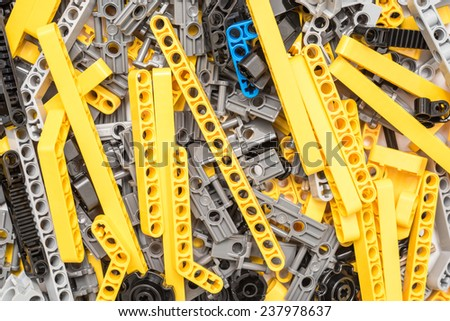BUCHAREST, ROMANIA - DECEMBER 16, 2014: Lego Technic Pieces Pile Close Up. Technic is a line of Lego interconnecting plastic rods and parts that creates more advanced models with complex movable arms.