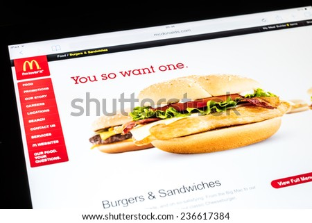 BUCHAREST, ROMANIA - DECEMBER 09, 2014: McDonald's Website On Apple iPad Air Tablet. Founded in 1940 in The United States it is the world's largest chain of hamburger fast food restaurants. - stock photo