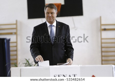 BUCHAREST, ROMANIA - DECEMBER 11, 2016: Romanian President Klaus Iohannis casts his vote in parliamentary elections.