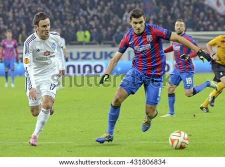 BUCHAREST, ROMANIA - DECEMBER 11, 2014: Serhiy Rybalka and Lucian Filip pictured during the UEFA Europa League last game between Steaua Bucurest and Dynamo Kyiv at National Arena. - stock photo